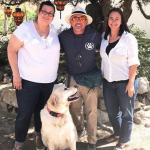 Television dog whisperer Cesar Milan standing with freedom writer Sue Ellen, freedom writers foundation founder Erin Gruwell, and freedom writer family dog, Beau the untrainable.