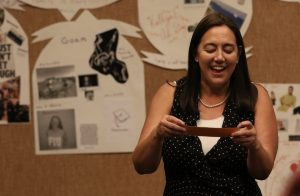 Freedom Writers Educator Erin Gruwell reads tweets in front of Coat of arms made by educators at our Freedom Writers Teachers Institute