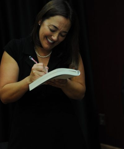 Erin Gruwell Signing the Freedom Writers Diary at one of her Keynote Speaking Engagements.